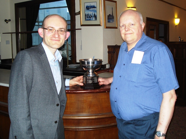 GM Matthew Sadler receives the Jack Wolstenholme Trophy from Tournament Organiser Simon Woodcock